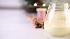 Traditional holiday egg nog garnished with freshly ground nutmeg. Stock Footage