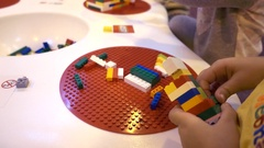 Children kids playing with Lego construction blocks Arkistovideo