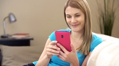 Beautiful attractive young woman with a smartphone communicating with friends Stock Footage