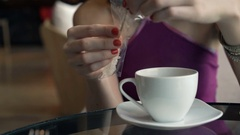 Woman hands adding sugar and mixing coffee in cafe  Stock Footage