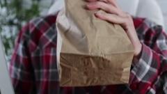 Man drinking bagged alchohol at office job Stock Footage