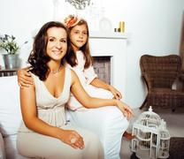 Happy smiling mother with little cute daughter at home interior, lifestyle Stock Photos