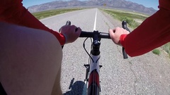 POV of a man road biking on a scenic road. Stock Footage