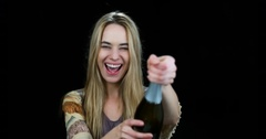 Happy woman opening champagne bottle in slow motion Stock Footage