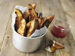 Rustic english potato chips Stock Photos