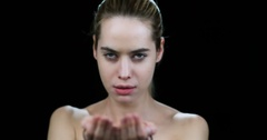 Crazy woman applying blood on her face in slow motion Stock Footage
