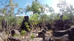 Walking through lost city of Litchfield NP Stock Footage