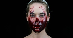 Crazy woman with blood on her face Stock Footage