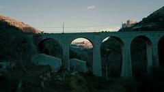 Aerial shot flying through arch frame Ragusa Ibla Stock Footage