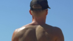A man jump serving while playing pro beach volleyball. Stock Footage