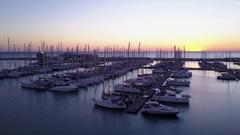 Sunset descending shot of sailboats at Marina di Ragusa Stock Footage