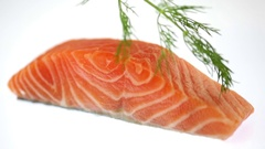 Fresh Raw Petite Salmon Filet Garnished with Dill Stock Footage