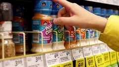 Woman buying Club house pop corn seasoning inside Price smart foods store Stock Footage
