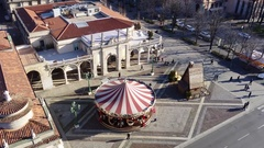 Bergamo, Italy, View of the carousel horses from the Memorial tower Stock Footage