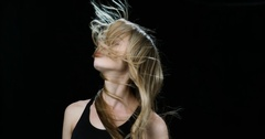 Blonde woman with windswept hair in slow motion Stock Footage
