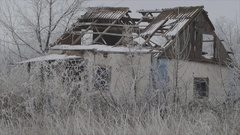 Old abandoned country house with a broken roof amongst winter snow. Ukraine. Stock Footage