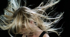Blonde woman's waving her hair in slow motion Stock Footage
