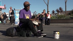 Street Performer Playing Drums For Donations Stock Footage