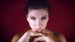 4k Studio Shot of a Golden Glittery Body Woman Posing Stock Footage