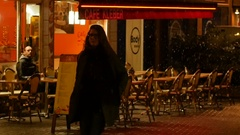 Slow motion woman walking with Single man at cafe table outdoor under snow Stock Footage