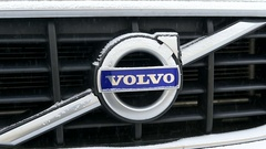 Volvo sweden logotype insignia on a cold winter day with snow Stock Footage