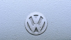 Tilt to to Vw Volkswagen logotype in Slow motion in a winters snowy day Stock Footage