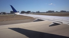The wing of an airplane as it takes off from LAX airport. Stock Footage