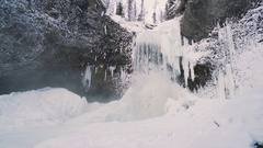 Winter Waterfall subtle pan left with person taking it in Stock Footage