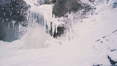 Winter Waterfall following subject or POV Stock Footage