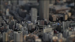 Japan tilt-shift, toy town tilted plane focus effect, pan to Tokyo Tower Stock Footage