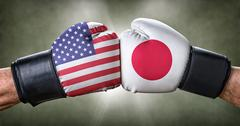 A boxing match between the USA and Japan Stock Photos