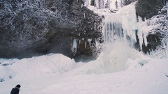 Winter Waterfall subtle pan right with person taking it in Stock Footage
