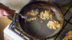 Potato Pancakes Fried in a Pan. Time Lapse Stock Footage