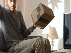 Man unboxing Amazon Prime box Stock Footage