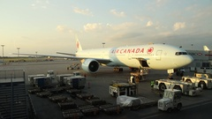 MONTREAL, CANADA - JUNE 27, 2016- Airplane being loaded at Trudeau Airport. Stock Footage