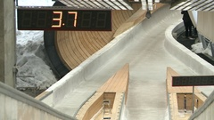 The bobsled and sledge go on the track Stock Footage