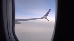 The wing of an airplane looking through the passenger window. Stock Footage
