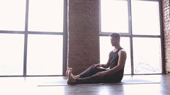 Portrait of a handsome man practicing meditation and yoga Stock Footage