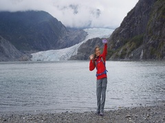 Tourist in Alaska taking selfie video by glacier Stock Footage