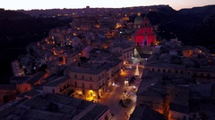 Aerial shot night flying over Ragusa Ibla piazza towards duomo Stock Footage