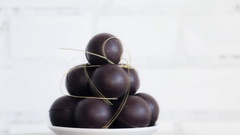 Pile of dark brown balls - chocolate sweets - slow rotation Stock Footage