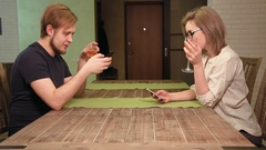 Young couple on a date is bored browsing the internet in their smartphones Stock Footage