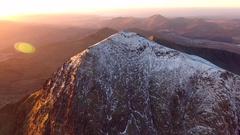 Long panning aerial orbit of Mount Snowdon at sunrise. Stock Footage