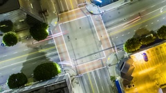 Vertical top down aerial view of traffic on street intersection at night Stock Footage
