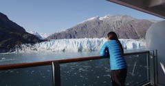 Alaska cruise ship passenger looking at glacier in Glacier Bay Stock Footage