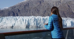 Tourist on cruise ship travel in Alaska looking at glacier Stock Footage