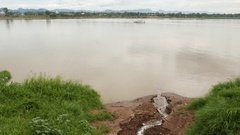 Sewage drains unthreated polluted waters into the Mekong River Stock Footage