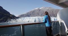 Tourist on Alaska cruise ship looking at glacier in Glacier Bay Stock Footage