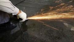 Grinding steel on the floor at work. Stock Footage
