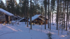 Moving at winter by cozy wooden house in snowy forest village. Stock Footage